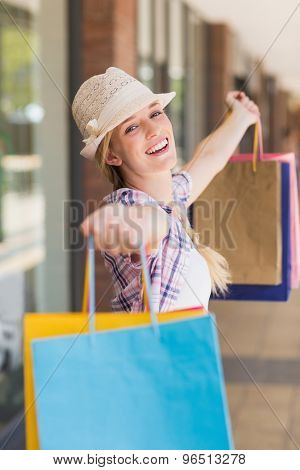 Portrait of a carefree woman holding shopping bags