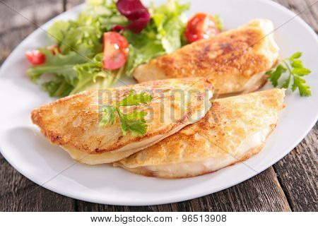 salad and crepe with cheese and ham