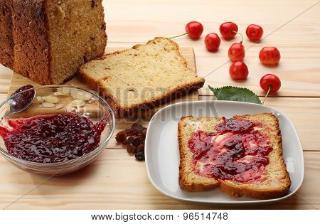 Sweet Bread  With Raisins And Almonds, Butter And Cherry Jam