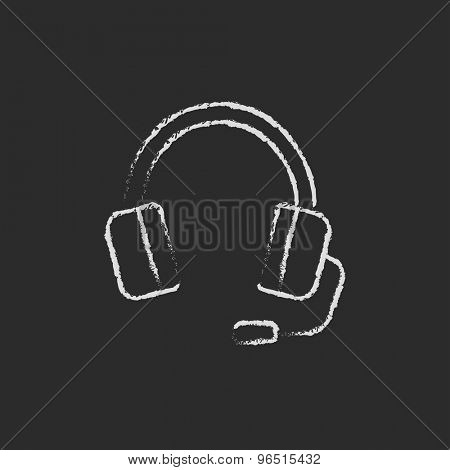 Headphone with microphone hand drawn in chalk on a blackboard vector white icon on a black background
