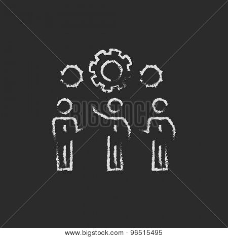 Businessmen holding a gear of a machine hand drawn in chalk on a blackboard vector white icon on a black background