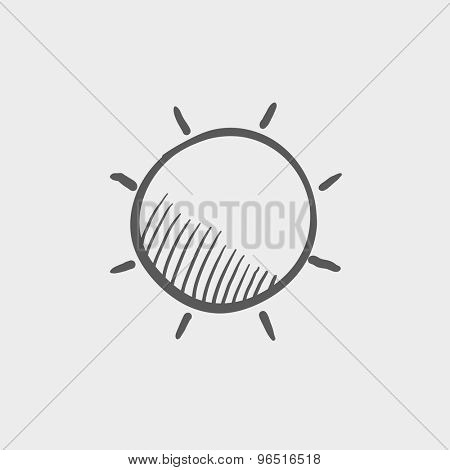 Sun sketch icon for web and mobile. Hand drawn vector dark grey icon on light grey background.