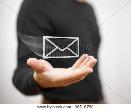 Man Holds A Virtual Postal Envelope, Concept Of Email, Internet And Networking