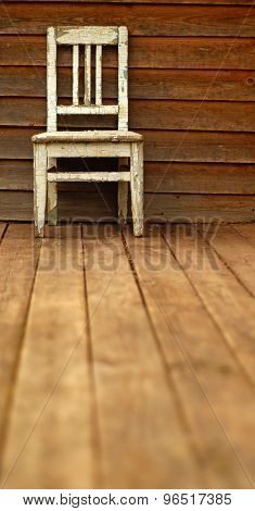 Still life with little old chair on wooden wall background