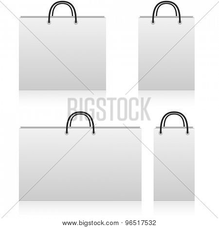 White paper shop bags of different sizes with copy space isolated on white background.