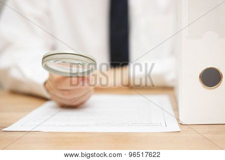 Businessman Is Reviewing Company Documentation On Workplace, Due Diligence Concept