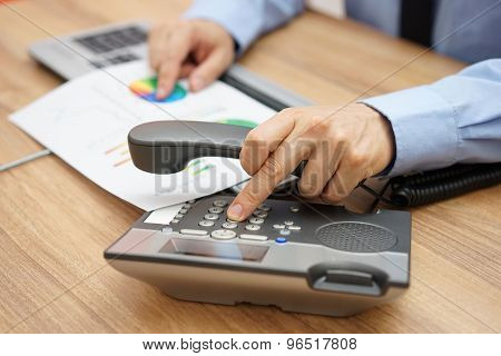 Businessman Calling Client To Inform Him Of The Company's Operations