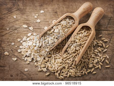 Oat flakes and seeds  in spoons
