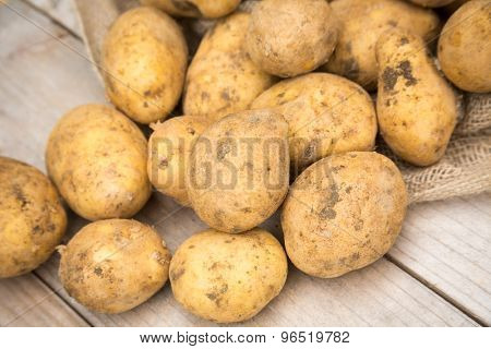 Dirty raw organic white potatoes
