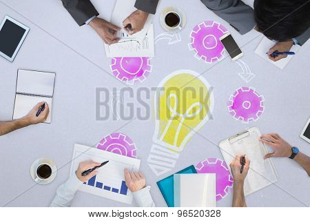 Business meeting against light bulb with cogs
