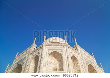 Close up detailed view of South side of Taj Mahal on blue sky.