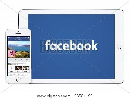 Facebook App On The White Apple Ipad Air 2 And Iphone 5S