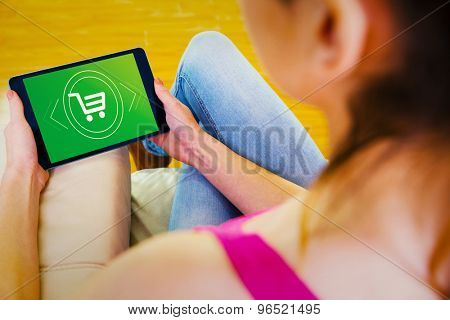 Woman using tablet at home against payment screen
