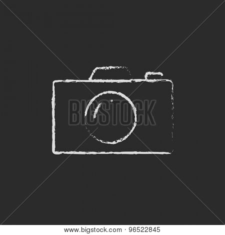 Camera hand drawn in chalk on a blackboard vector white icon on a black background