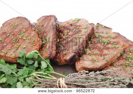 barbecued beef meat on pan isolated on white background