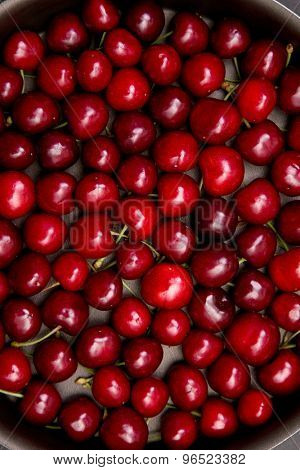 Sweet fresh cherry background, top view