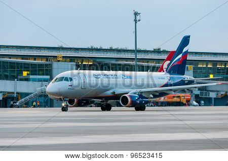 KIEV, UKRAINE - JULY 10, 2015: Aeroflots  SSJ 195-b taxis to teminal at KBP Airport on January 12, 2
