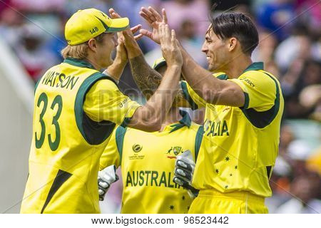 LONDON, ENGLAND - June 17 2013: Shane Watson and Mitchell Johnson celebrate the wicket of Lahiru Thirimanne during the ICC Champions Trophy international cricket match between Sri Lanka and Australia.