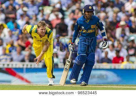 LONDON, ENGLAND - June 17 2013: Australia's James Faulkner and Sri Lanka's Mahela Jayawardene during the ICC Champions Trophy international cricket match between Sri Lanka and Australia.