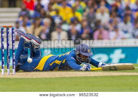 LONDON, ENGLAND - June 17 2013: Sri Lanka's Tillakaratne Dilshan dives in to make his ground during the ICC Champions Trophy international cricket match between Sri Lanka and Australia.