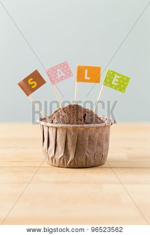 Flag on muffin with a word sale