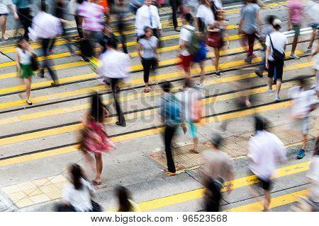 Motion blurred pedestrians crossing Hong Kong street
