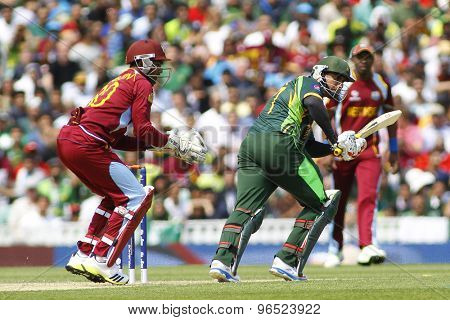 LONDON, ENGLAND - June 07 2013: West Indies Denesh Ramdin and Pakistan's Nasir Jamshed during the ICC Champions Trophy cricket match between Pakistan and The West Indies at The Oval Cricket Ground.
