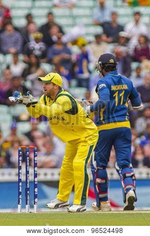 LONDON, ENGLAND - June 17 2013: Australia's Matthew Wade  and Sri Lanka's Kumar Sangakkara during the ICC Champions Trophy international cricket match between Sri Lanka and Australia.