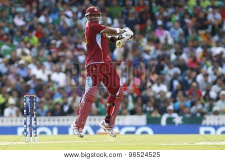 LONDON, ENGLAND - June 07 2013: West Indies Kieron Pollard batting during the ICC Champions Trophy cricket match between Pakistan and The West Indies at The Oval Cricket Ground.