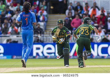 EDGBASTON, ENGLAND - June 15 2013: Ishant Sharma Kamran Akmal and Mohammad Hafeez during the ICC Champions Trophy cricket match between India and Pakistan at Edgbaston Cricket Ground.