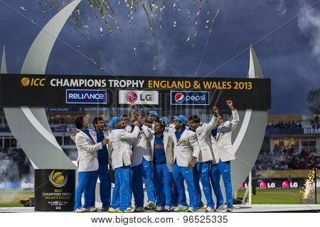 EDGBASTON, ENGLAND - June 23 2013: India celebrate with the trophy after winning the ICC Champions Trophy final cricket match between England and India at Edgbaston Cricket Ground