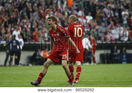 MUNICH, GERMANY May 19 2012. Bayern's German forward Thomas Muller celebrates scoring during the 2012 UEFA Champions League Final at the Allianz Arena Munich contested by Chelsea and Bayern Munich