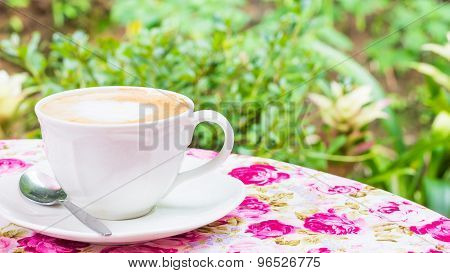 White cup of Cappuccino on the table