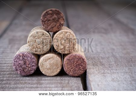 Close Up Of Stacking Corks For Wine Bottles On A Wooden Background With Copyspace For Your Festive.