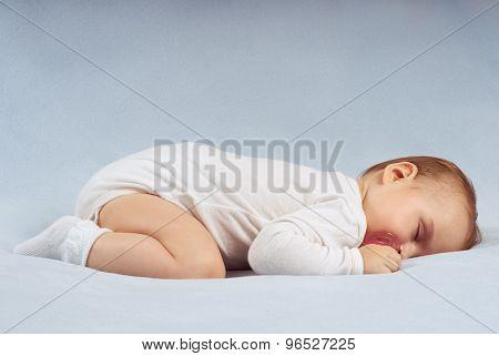 Baby Sleeps On Soft Blue Blanket