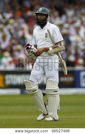 LONDON, ENGLAND. AUGUST 16 2012 South Africa's Hashim Amla walks off after being dismissed during the third Investec cricket  test match between England and South Africa, at Lords Cricket Ground