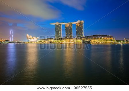 Singapore Skyline And Merlion At Twilight