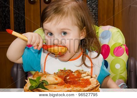 Little Girl Eating Red Caviar Wooden Spoon
