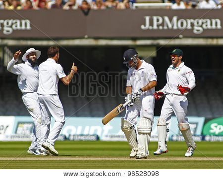 LONDON, ENGLAND. AUGUST 20 2012 England's Jonathan Trott walks off as South Africa celebrate during the third Investec cricket  test match between England and South Africa, at Lords Cricket Ground