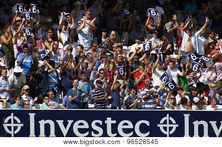 LONDON, ENGLAND. AUGUST 20 2012 The crowd signal six runs during the third Investec cricket  test match between England and South Africa, at Lords Cricket Ground
