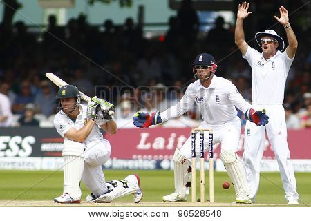 LONDON, ENGLAND. AUGUST 19 2012 England's Andrew Strauss and England's Matt Prior appeal for the wicket of South Africa's AB de Villiers during the third test match between England and South Africa