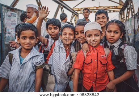 MUMBAI, INDIA - 12 JANUARY 2015: Indian children after school in Dharavi slum. Post-processed with grain, texture and colour effect.