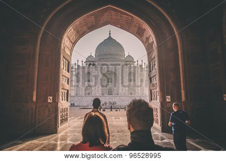 AGRA, INDIA - 28 FEBRUARY 2015: View of Taj Mahal from mosque with people. West side. Post-processed with grain, texture and colour effect.