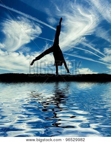 Little ballet dancer make cartwheel isolated on a white background
