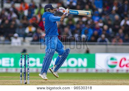 EDGBASTON, ENGLAND - June 23 2013: India's Mahendra Singh Dhoni hits the ball and is dismissed off the bowling of Ravi Bopara during the ICC Champions Trophy final  match between England and India