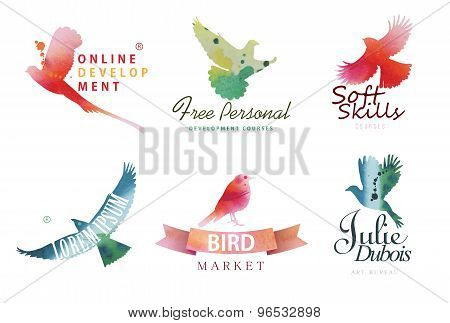 Watercolor logo templates. Colorful birds silhouettes in watercolor technique.