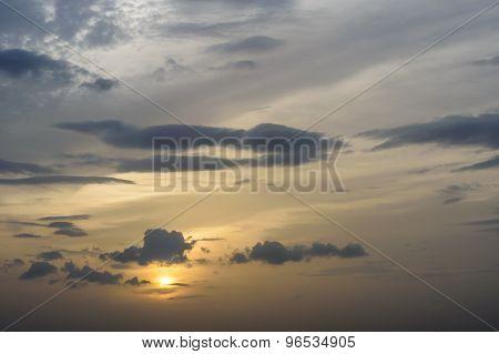 Golden Sunset Against Dark Clouds