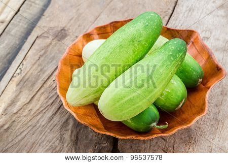 Fresh Cucumber In Wooden Plate On Wooden Table