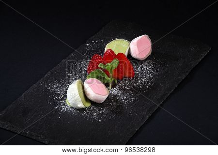 Half Scoops Of Ice Cream With Strawberries And Sugar