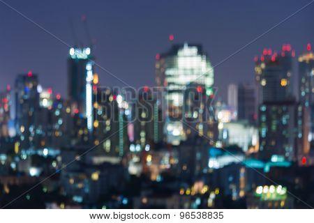 Abstract blurred bokeh of Bangkok business park light at night